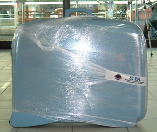 plastic-wrap-suitcase