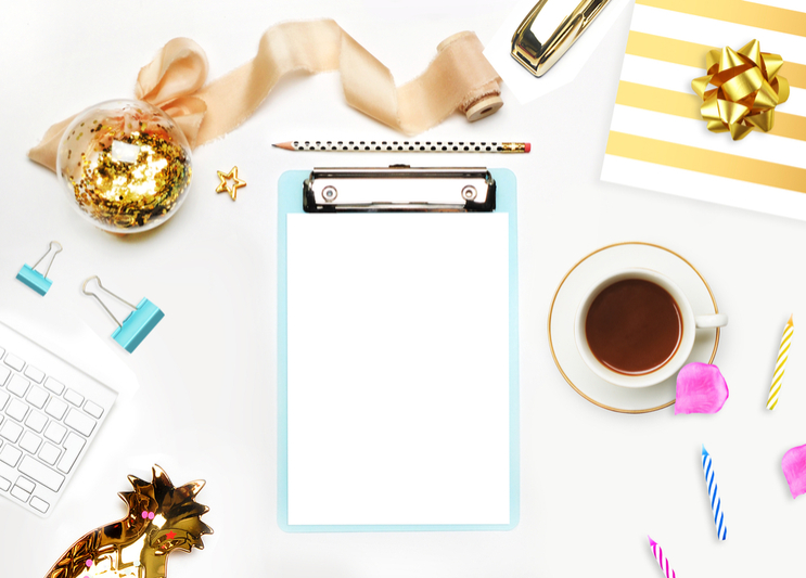 Event planner clipboard, coffee, and swatches