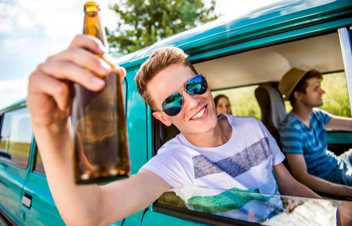 Teens drinking beer driving