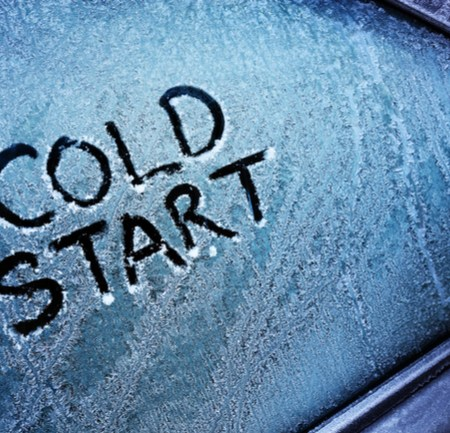 "Frosted over car window with writing ""Cold Start"""