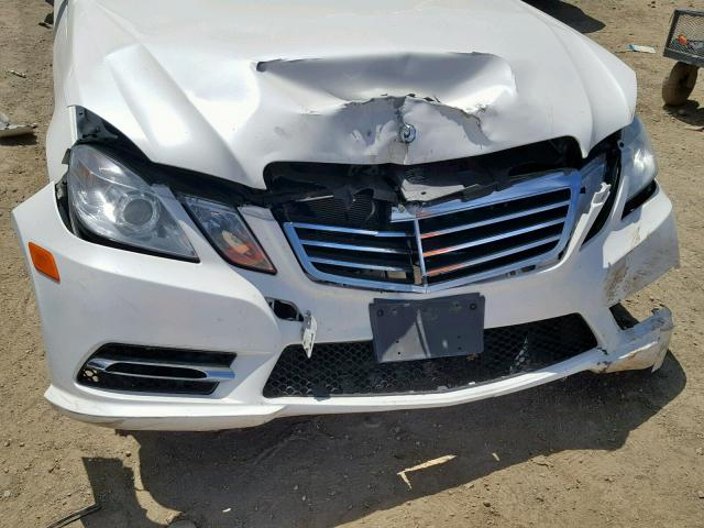 closeup of damage to front end of 2013 white Mercedes