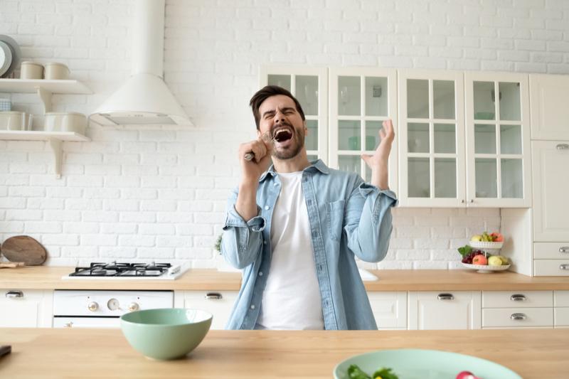 man singing in the kitchen