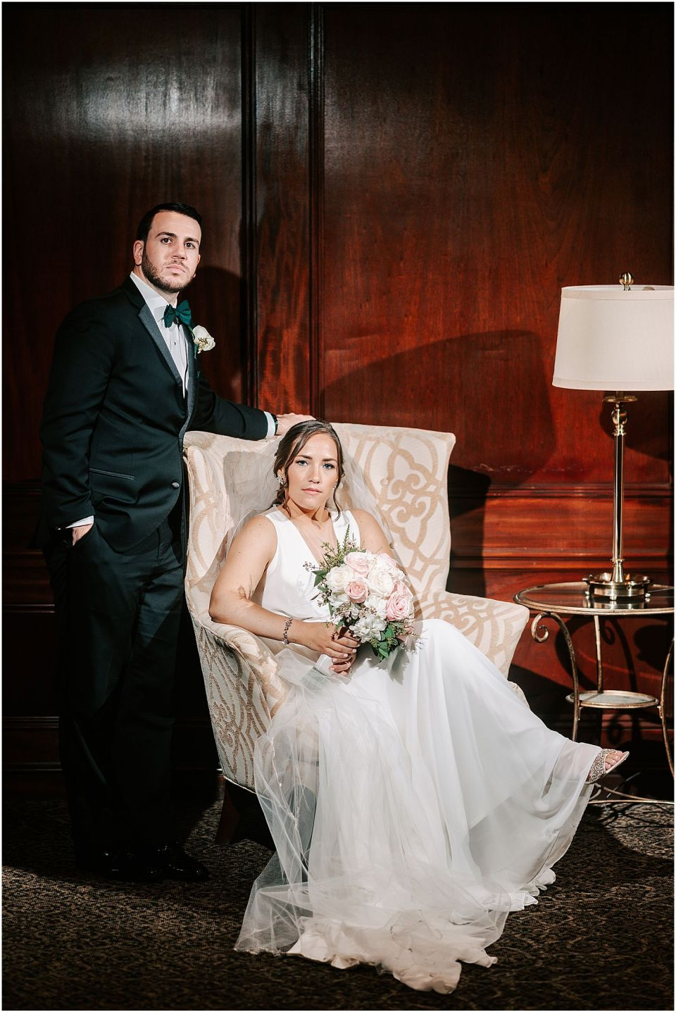 A dark and moody portrait of the couple at this Olde Mill Inn Wedding