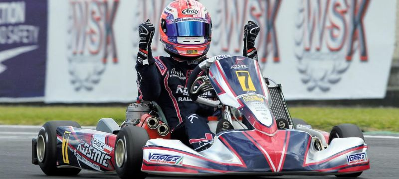 Basz K. celebrating on his Kosmic kart
