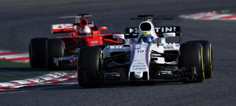 Williams Massa infront of the Ferrari in testing at Barcelona