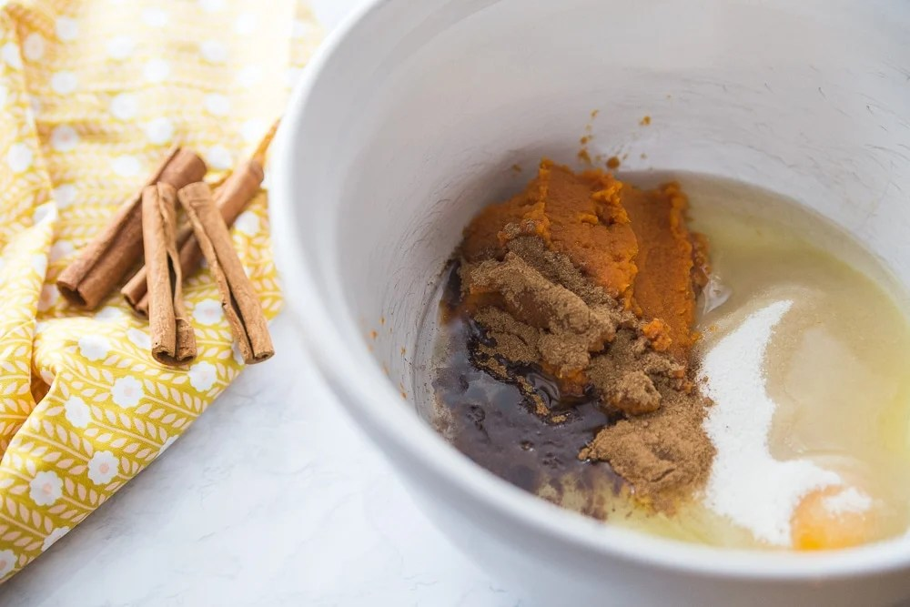 pumpkin pie spices in bowl with egg and sugar free sweetener