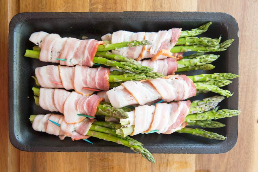 Make this Keto Grilled Bacon Wrapped Asparagus Recipe as a perfect side to your favorite grilled steak or chicken recipe. This is so easy and delicious! A perfect keto side dish recipe that fits into any low carb diet plan!