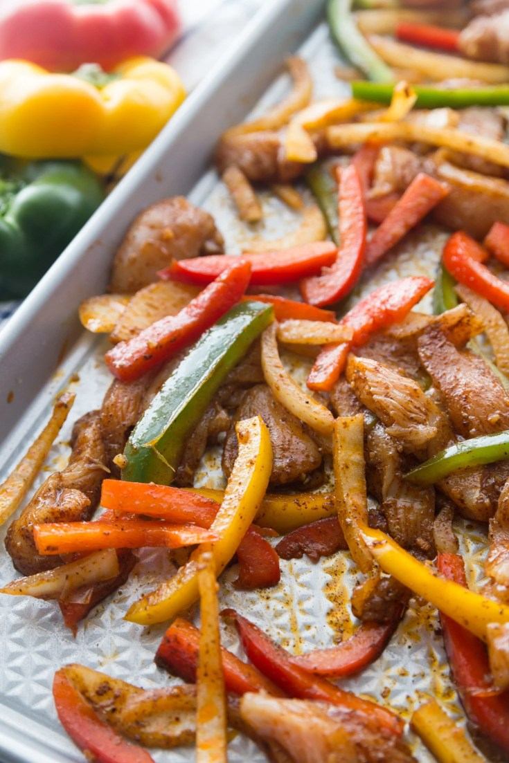 low carb baked chicken fajitas cooked on a sheet pan