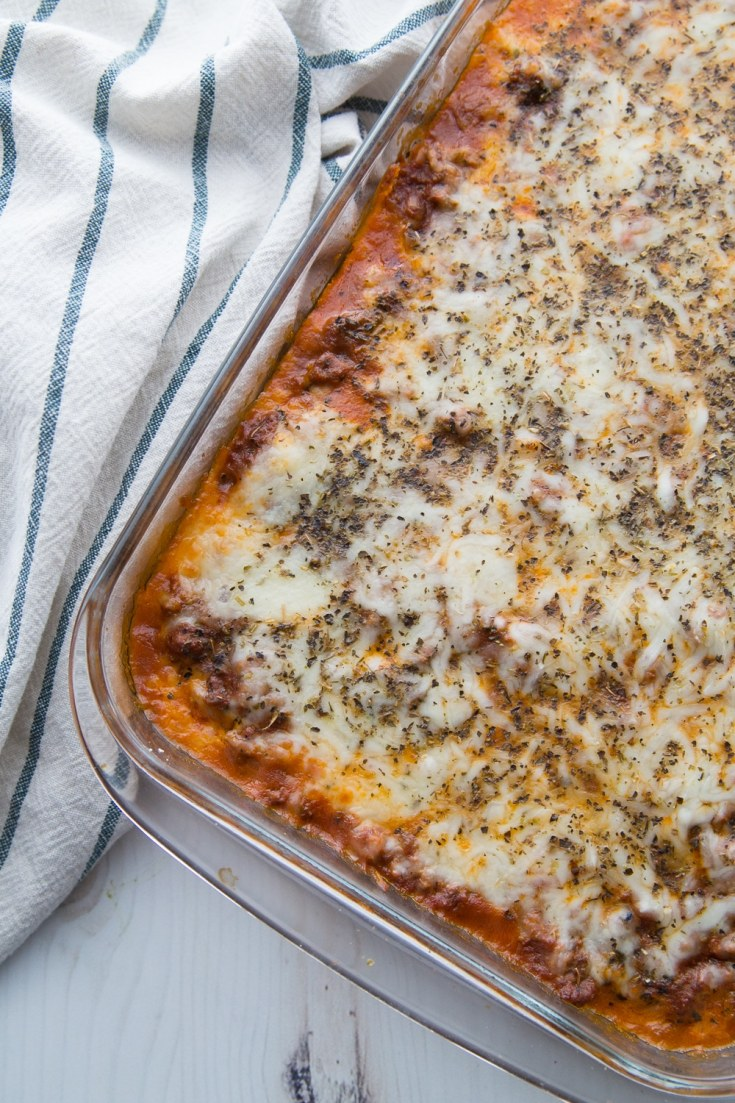 delicious keto lasagna fresh out of the oven in a casserole dish