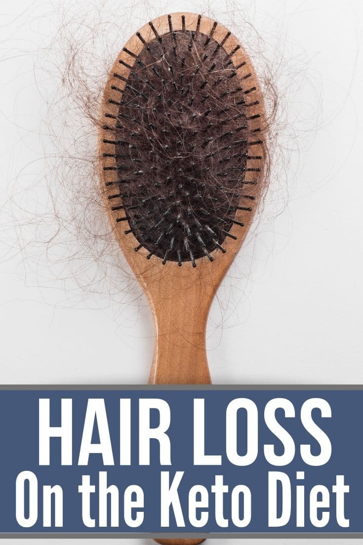 brush with a bunch of hair in it from hair loss on keto