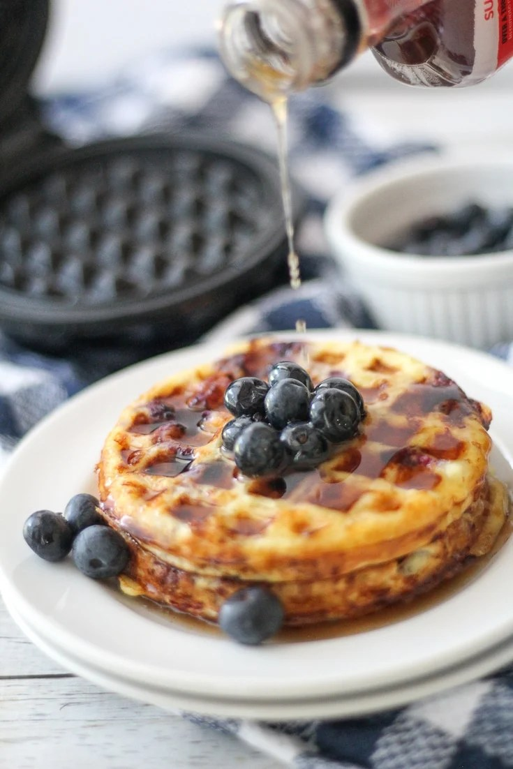 blueberry Keto Chaffle recipe plated with maple syrup on top