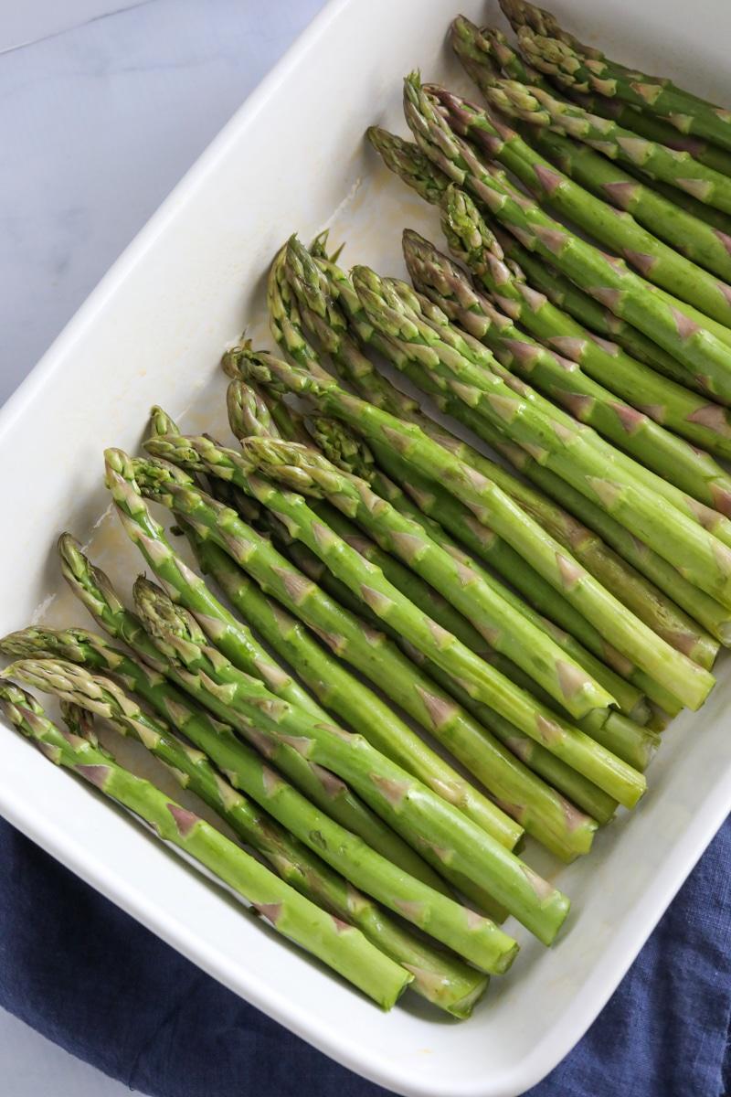 Asparagus in a white pan.