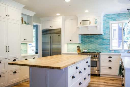 White Kitchen with Bold Blue Backsplash