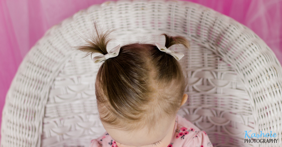Image of baby girl's pigtails from Miss Hardy's First Birthday Session