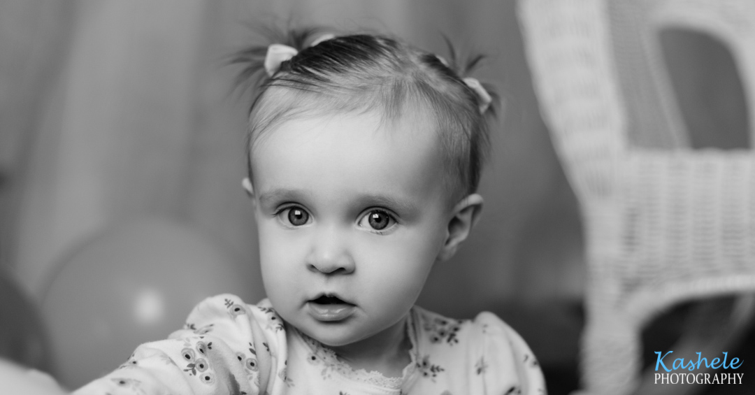 Closeup image of baby girl from Miss Hardy's First Birthday Session