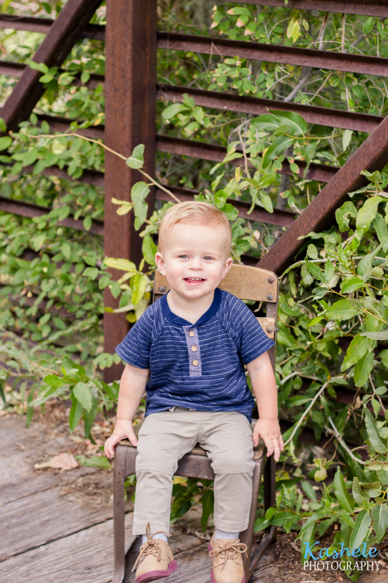 Utah County Milestone Photography session image of little boy smith sitting on a chair