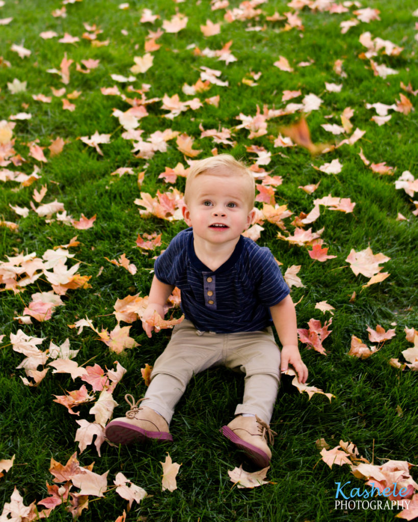 Image of little man Smith surrounded by leaves.