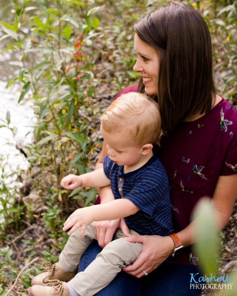 Image of little man Smith with his mom by the stream