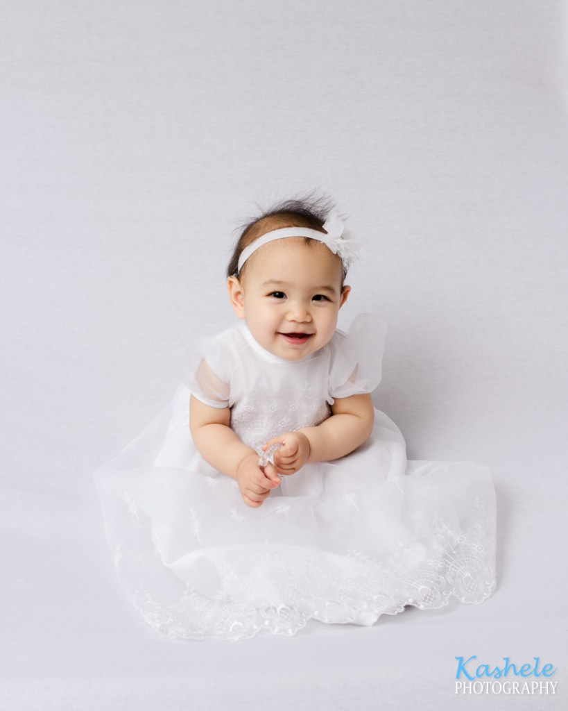 smiling baby girl in white
