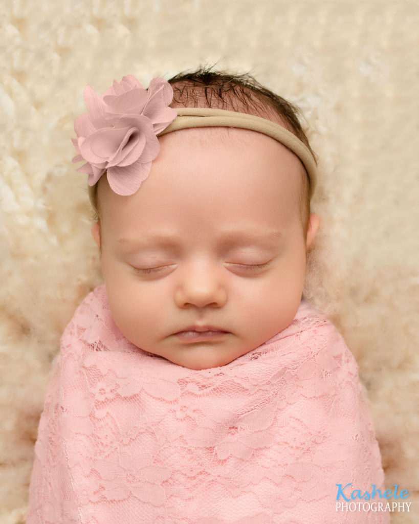 Headshot of baby girl in pink