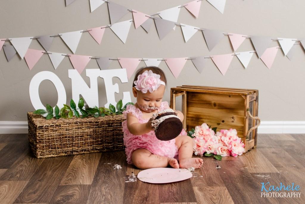 Little girl picking up her cake
