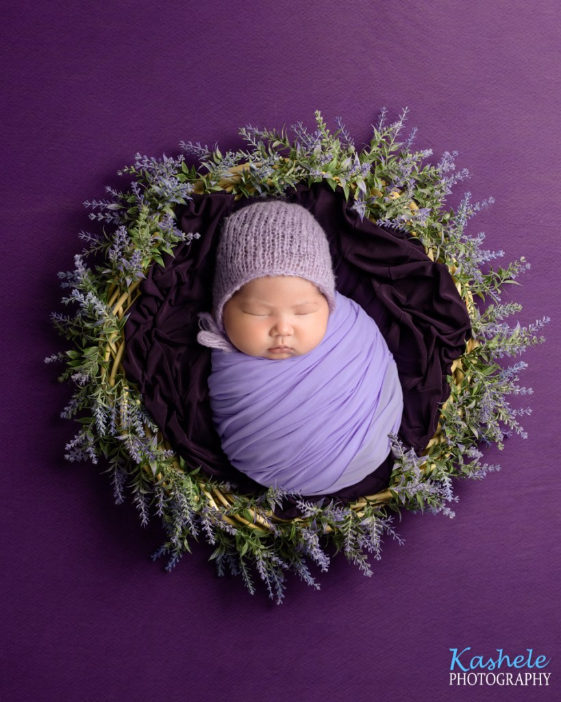 Image of baby girl in a wreath of lavender for Eagle Mountain Newborn Photography post