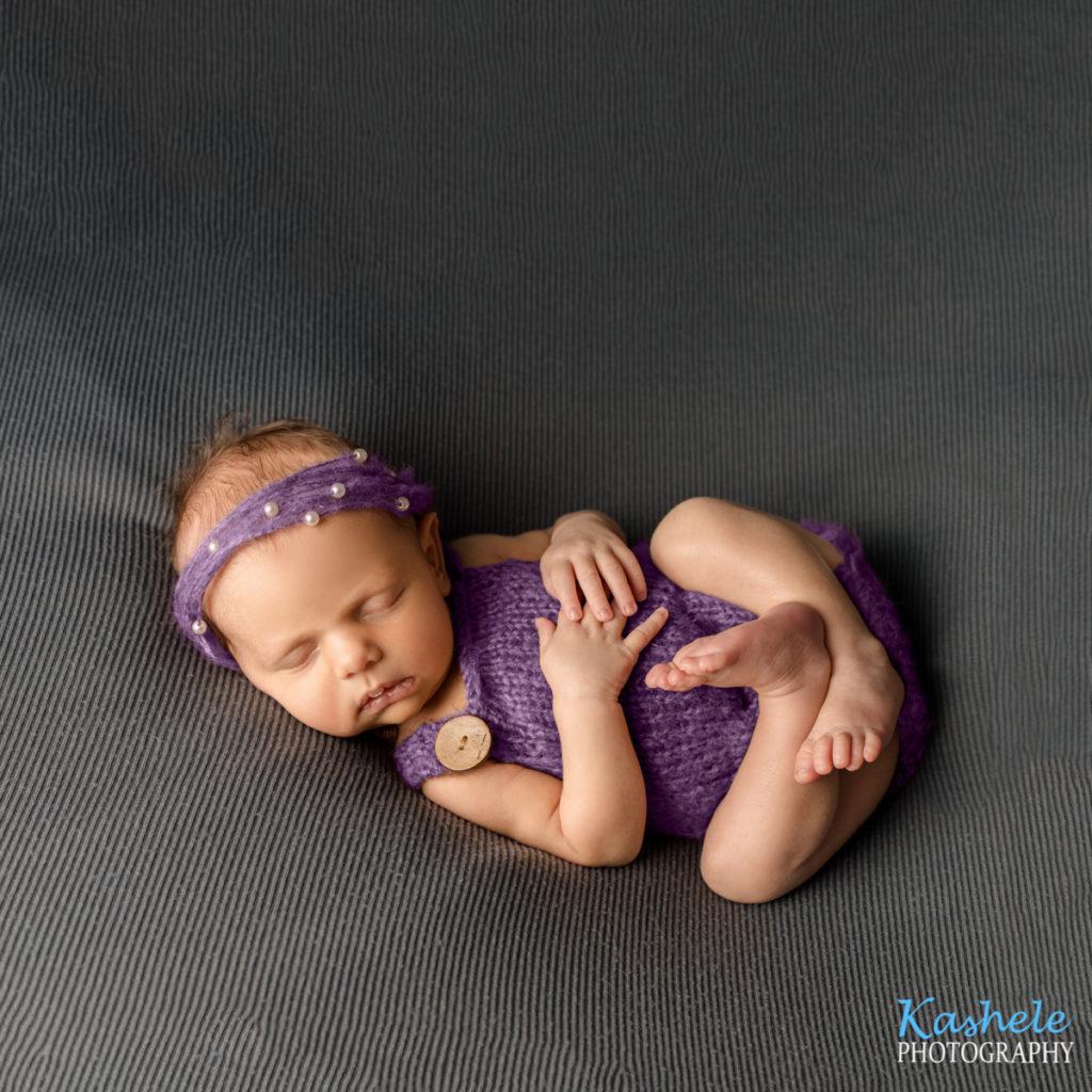 Huck Finn pose in gray and purple