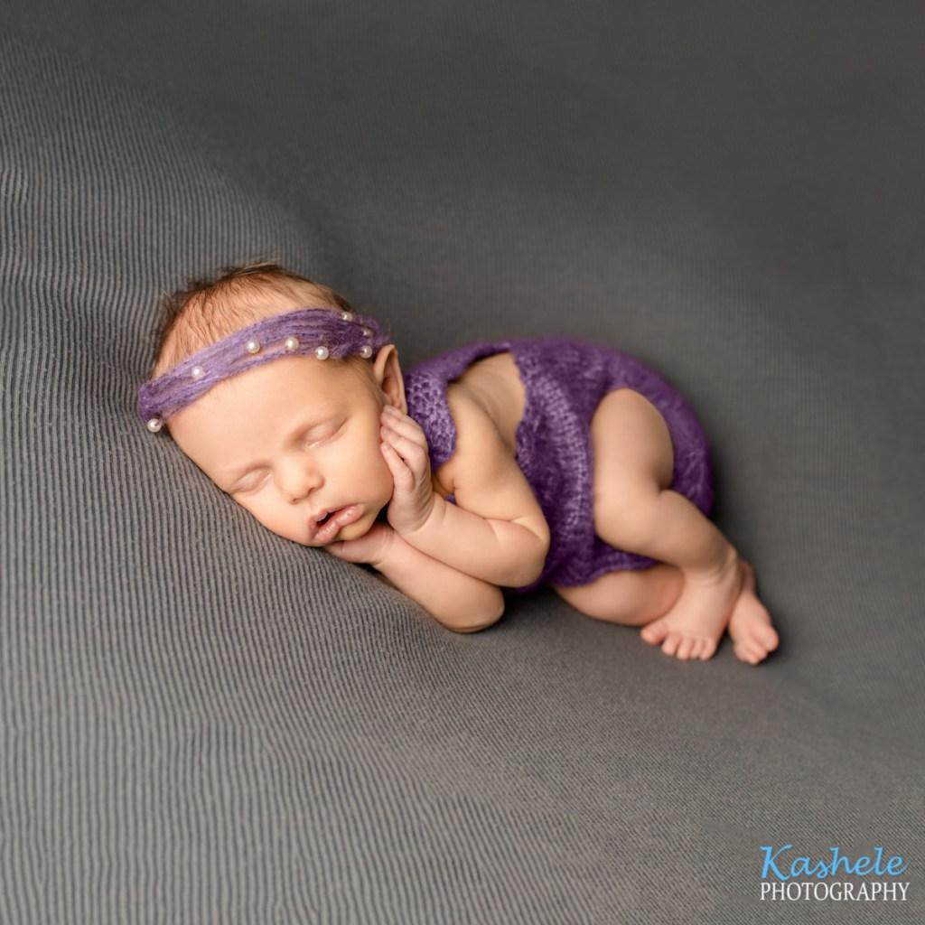 Side lying pose for Logan Newborn Photographer post