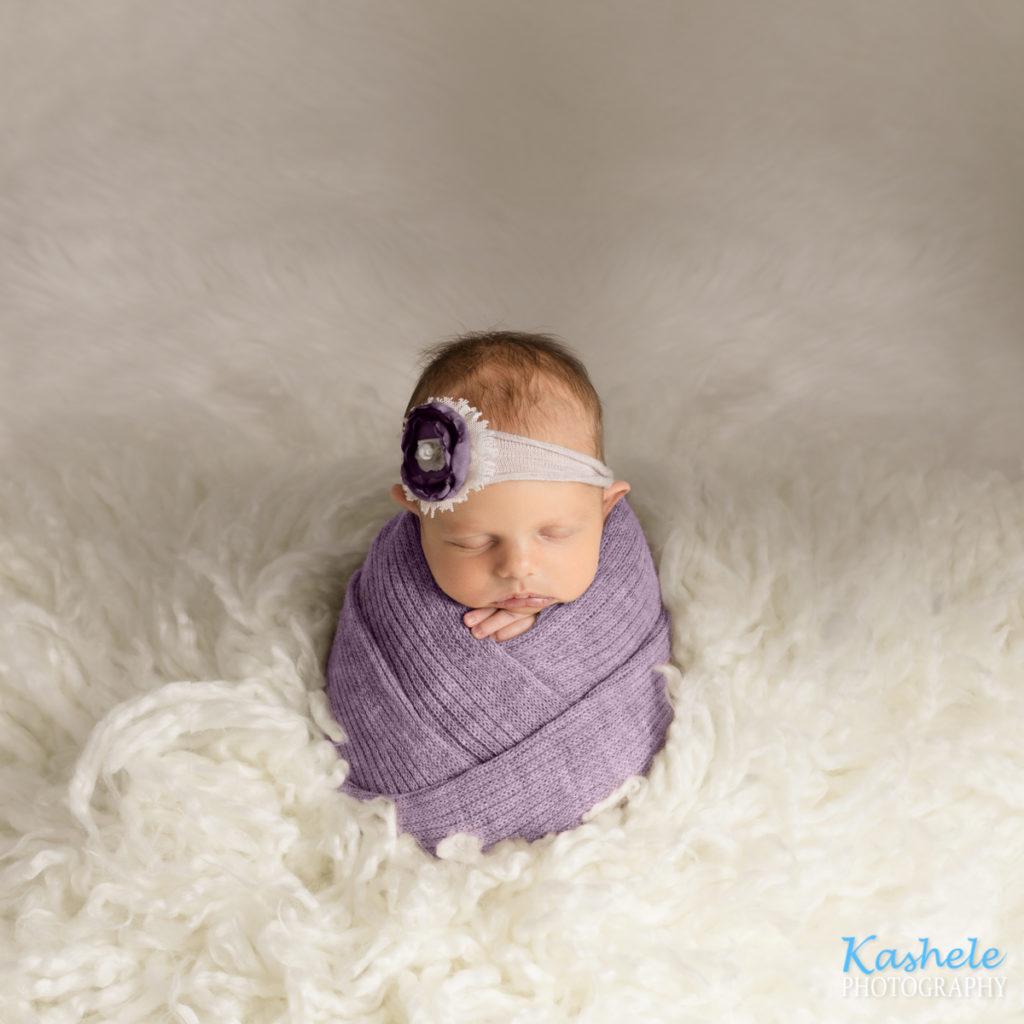 Purple potato sack pose for Logan Newborn Photographer post