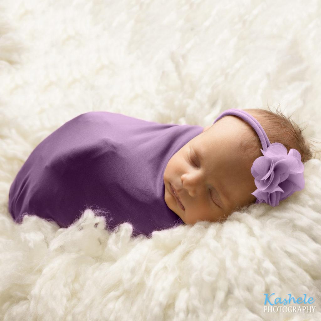 Backlit shot of baby in purple