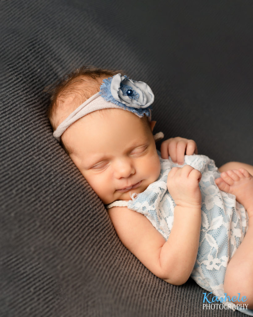 Image of baby girl for Logan Newborn Photography post
