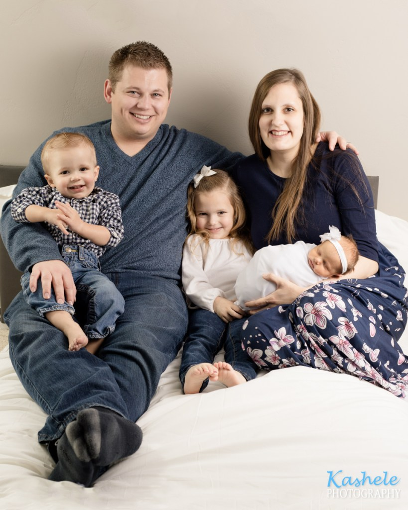 First family portrait for Logan Newborn Photography post