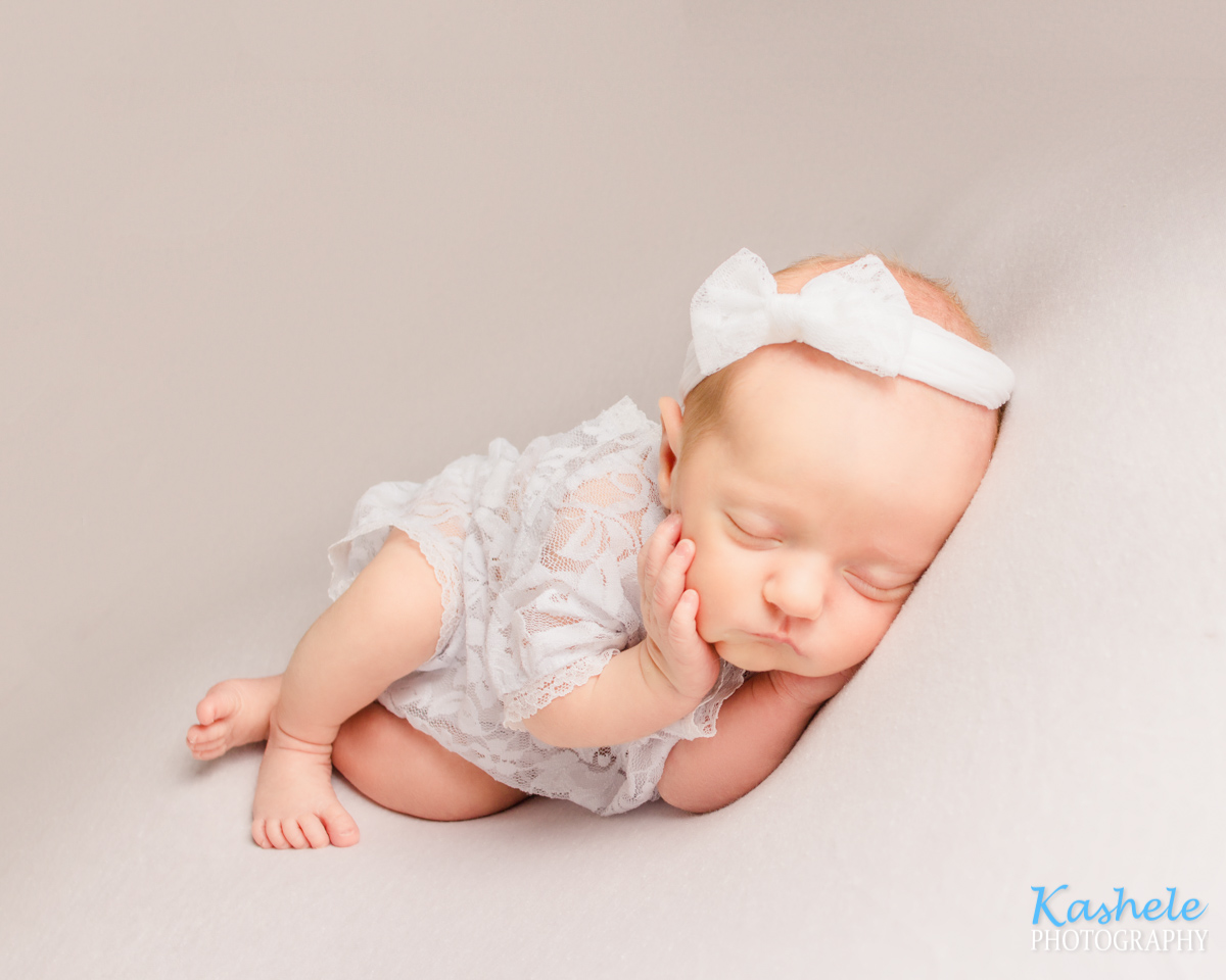 Side lying pose for Newborn Photography Cost Post