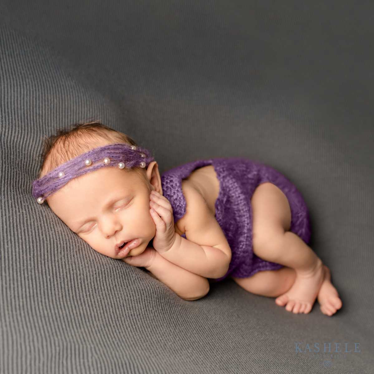 Side lying pose for Logan Newborn Photographer post