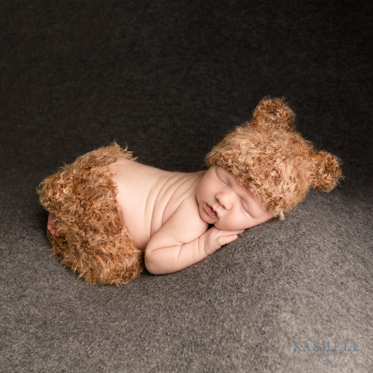 Image of baby boy in Huggalugs bear set doing bum up pose