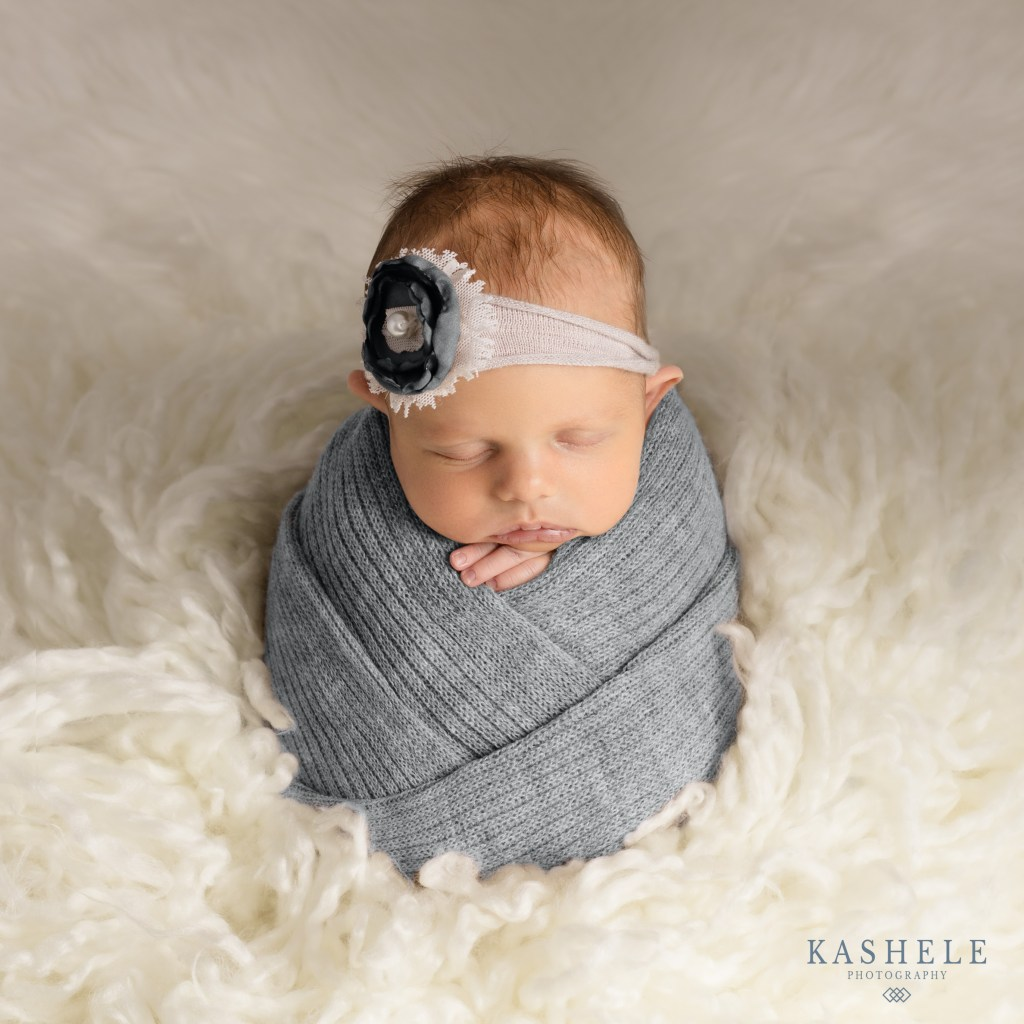 Image of a newborn posed safely using advanced photography techniques
