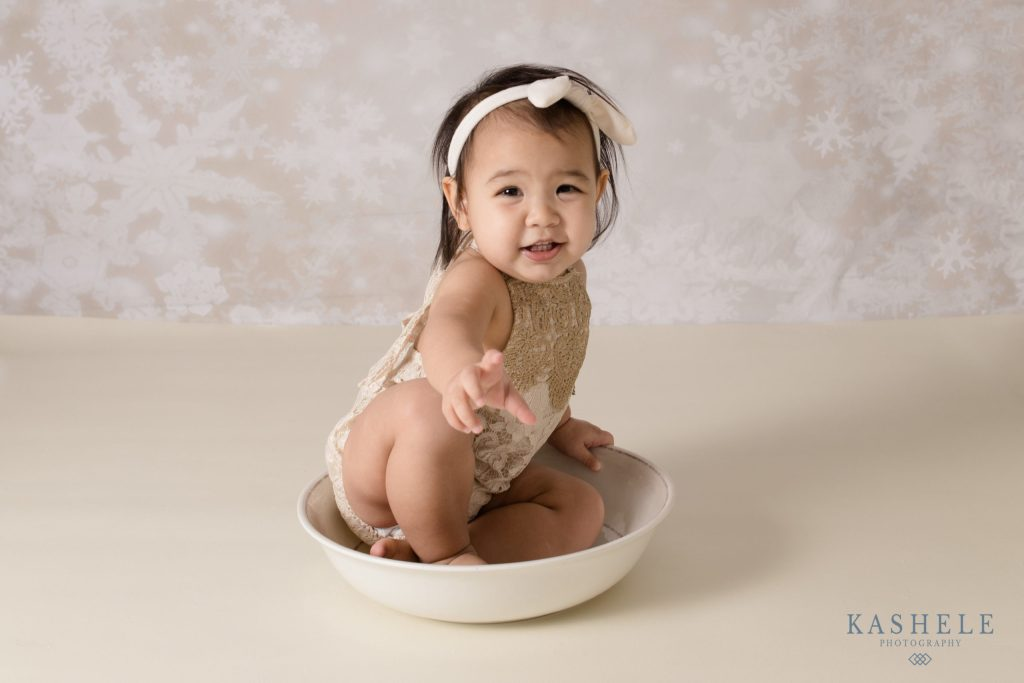 Image of little girl in bowl for Milestone session
