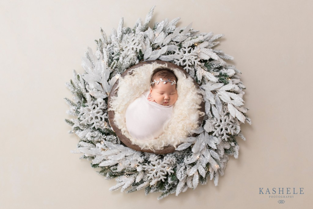 Baby girl in a snowy wreath