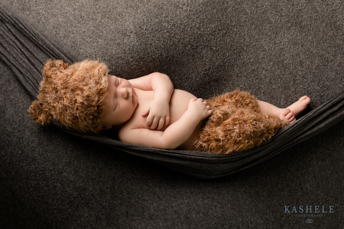 Newborn baby boy in a hammock