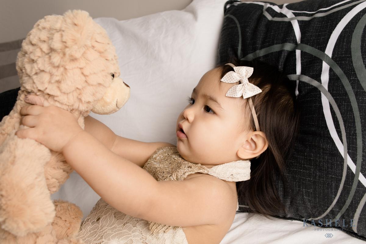 Little girl with a bear