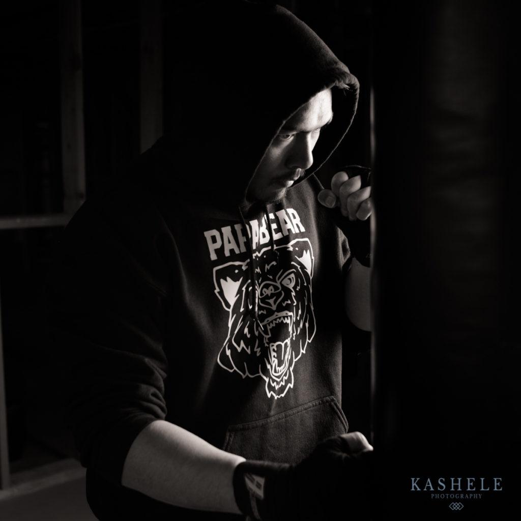 Man boxing in papa bear hoodie