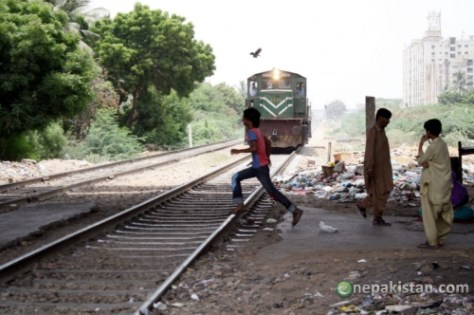 Children Moving Across Coming Train