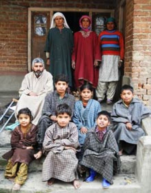 A Villager Family from Bandipora involved in the cultivation of Chest nuts