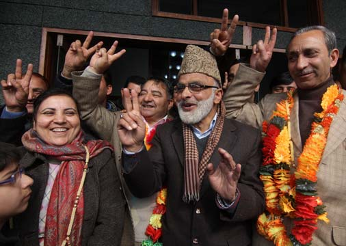 Ali Mohammad Sagar celebrating the victory of Coalition candidates. Monga and Dar are also in the picture. -- Photo: Bilal Bahadur