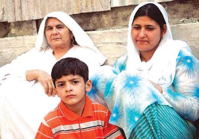 Mother Ayesha Begum, Wife Tabasum and son Ghalib of Azal Guru outside their house