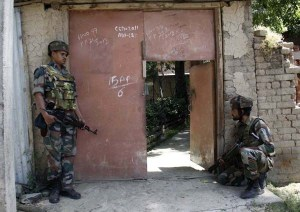 Army jawans taking position during a gun battle with militants at Harbouch Tral in Pulwama on Friday in a gun battle between Militants and Army, Four Army Personals were killed and one Militant Gun down  photo by bilal bahadur