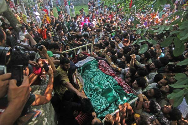 Hundreds of people gather in Dadsar village in south Kashmir's Pulwama district to bid adieu to Hizb militant Shahnawaz Ahmad who was killed in an encounter in Tral on July 1, 2013.