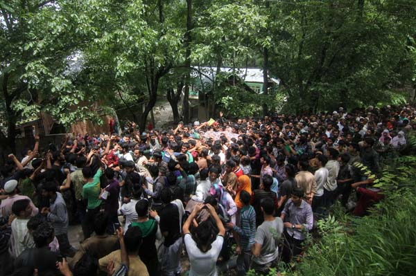 In Hayena village, a huge procession carried Hizbal Mujahideen's district commander, Shabir Ahmad Bhat alias Adil's body to a local graveyard for burial.  Shabir was killed on July 1, 2013 during an encounter with army and police in Tral.