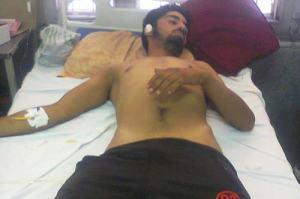Jan Mohammad Khandey lying on bed in SKIMS, Srinagar.
