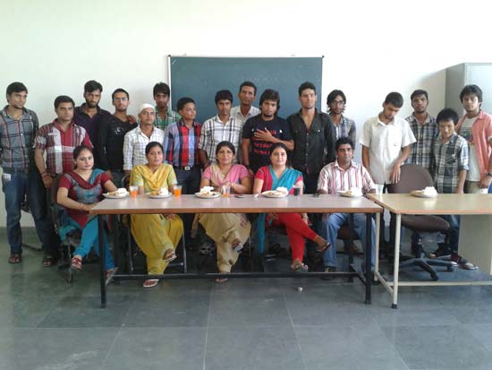 Aadil Habib Bhat (standing 3rd from left) with his teachers and college mates.
